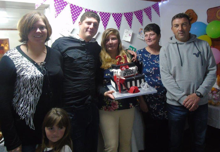 Leanne Swain with her family at her 21st birthday party.