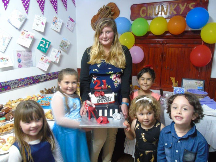 Leanne Swain with her godchildren at her 21st birthday party.