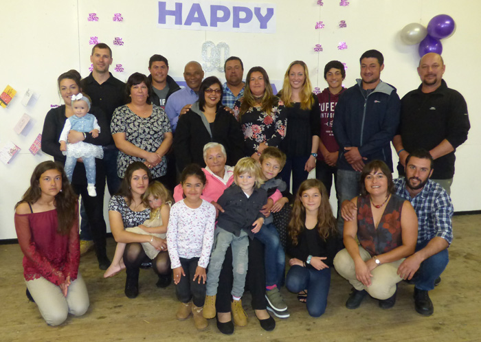 Isobel Swain with her grandchildren and their partners.