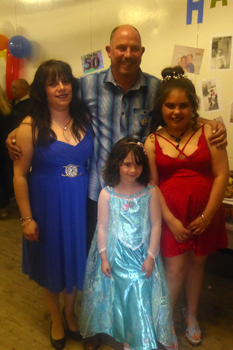 Paul Repetto with wife and daughters