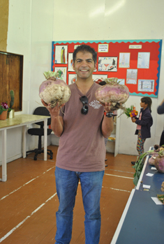 Aniket holding two turnips