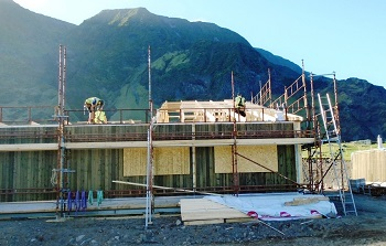 Erecting roof struts on the Camogly Healthcare Centre