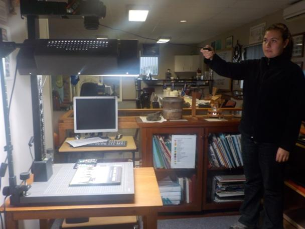 Practicing with the photography equipment in the new archive room.