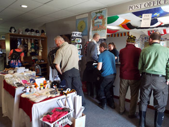 MV Plancius passengers buying stamps and souvenirs.