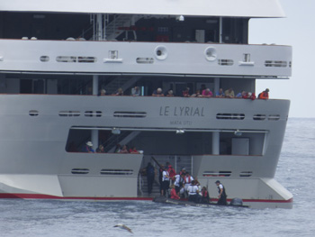 Passengers re-embarking at Le Lyrial's stern.