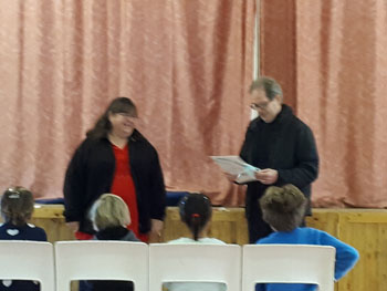 Presentation to Peter Foster at school assembly