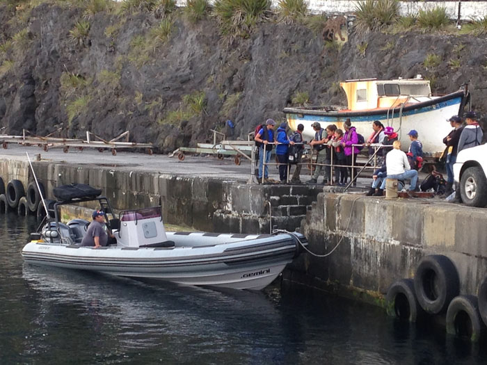Students gather at the harbour for their trip to Cave Point