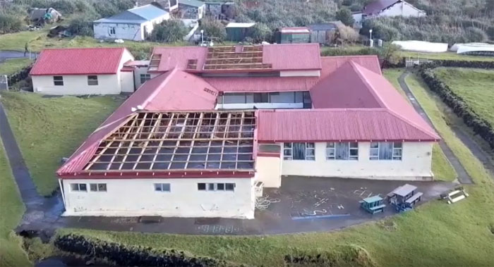 Aerial view from the east of the storm damage to St Mary's School, Tristan da Cunha