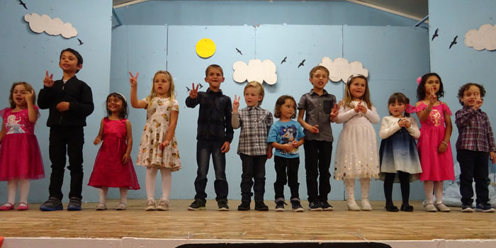 Play group and Class 1 singing (along with actions) to a Christmas Carol