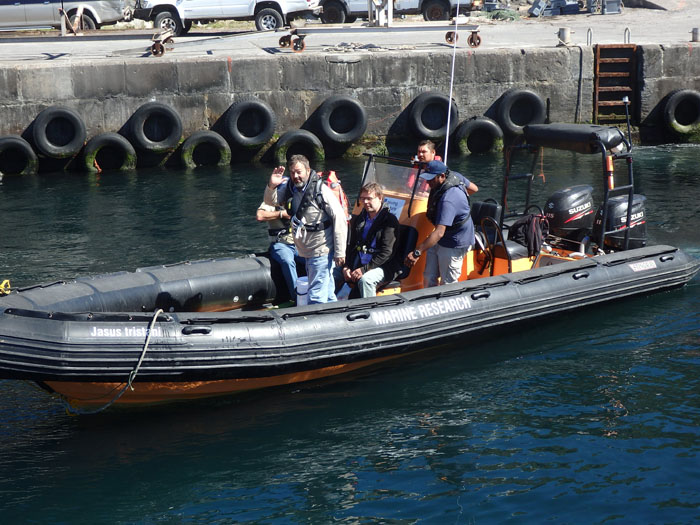 The crew from the SV Urchin being brought into Calshot Harbour in the Conservation RIB