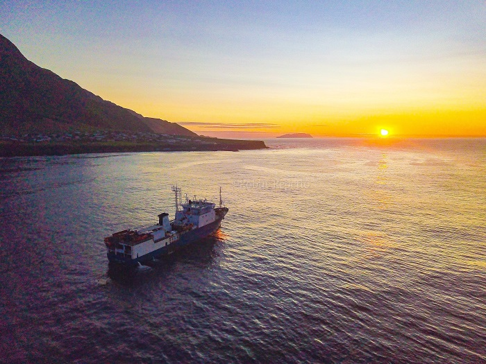 Sunset for the MFV Geo Searcher, pictured off the Settlement at Tristan da Cunha.
