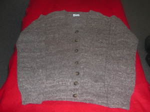 Cardigan in local black wool.