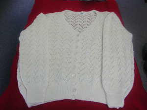 Cardigan in local white wool.