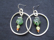 TT11 - Sterling silver earrings containing small beach stone or seaglass, 6cm drop
