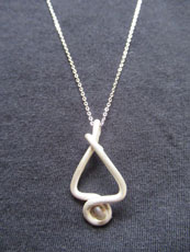 TT13 - Sterling silver necklace containing small beach stone or seaglass (2) 25cm length