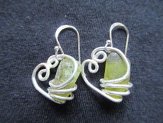 TT31 - Sterling silver earrings containing small beach stone or seaglass, 3cm drop