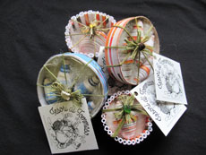 TT70 - Packaged Christmas baubles made from paper back 6cm x 5cm set of 4 6cm x 2cm front 8.5cm x 4 cm